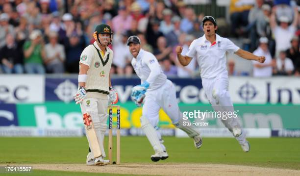 Australain batsman David Warner looks on as Matt Prior and Alastair Cook celebrate his dismissal during day four of 4th Investec Ashes Test match...