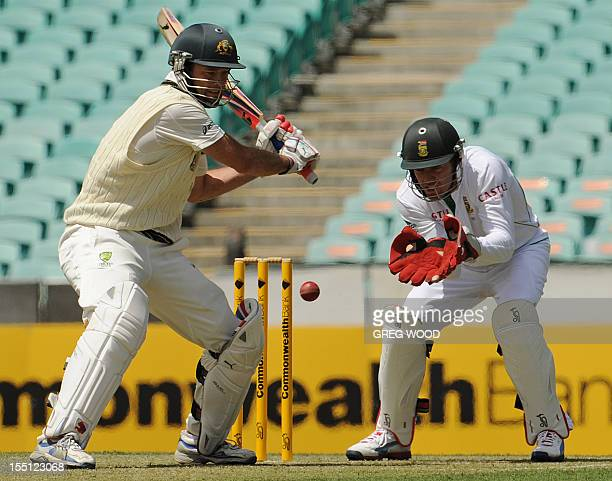 Australia 'A' batsman Rob Quiney prepares to play the ball watched by South Africa's AB Devilliers during their threeday cricket tour match at the...