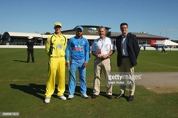 Australia A captain Peter Handscomb India A captain Manish Pandey Mackay mayor Greg Williamson and match referee Steve Benaud pose before the coin...