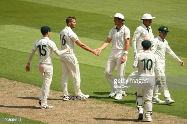 Australia A players celebrate the wicket of Tom Abell of the England Lions during the Four Day match between Australia A and the England Lions at...