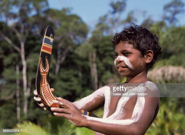 Australia, Aborigine Boy Throwing Boomerang
