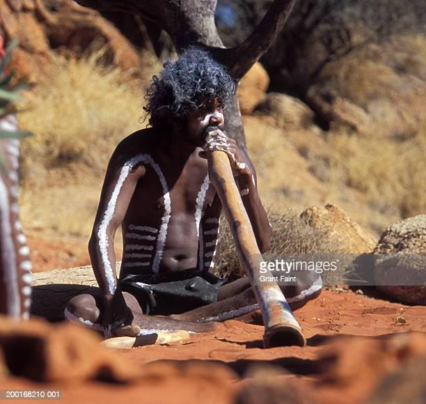Australia, Alice Springs,  Aboriginal man playing dide