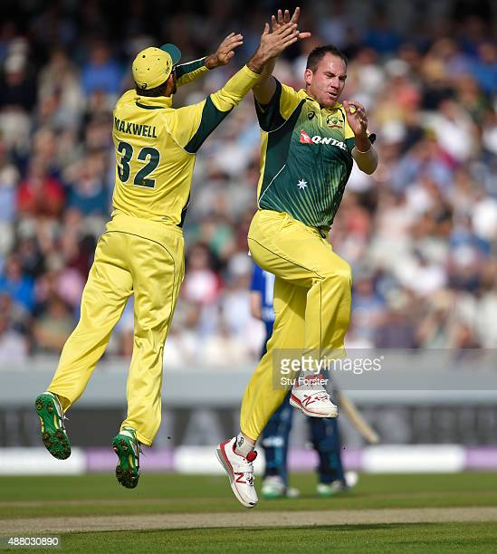 Australia and Durham seamer John Hastings celebrates with Glenn Maxwell after dismissing England batsman James Taylor during the 5th Royal London...