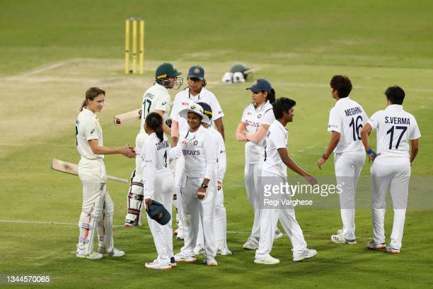 Australia and India players greet each other after their historic day-night Women's International Test Match ended in a draw at the end at Metricon...