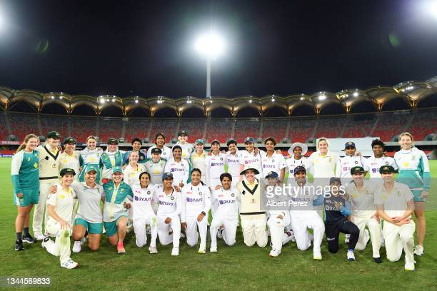 Australia and India pose for a photo during day four of the Women's International Test Match between Australia and India at Metricon Stadium on...