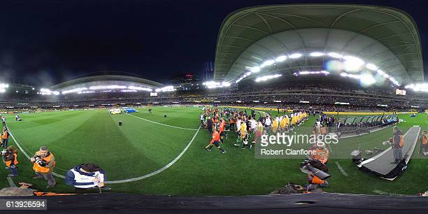 Australia and Japan walk out for the 2018 FIFA World Cup Qualifier match between the Australian Socceroos and Japan at Etihad Stadium on October 11...