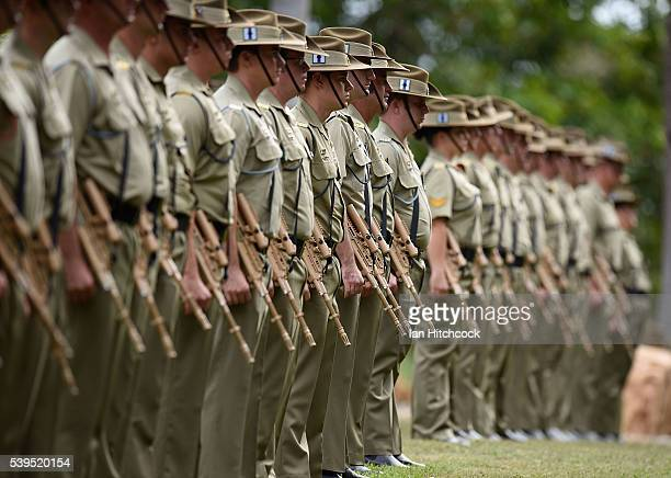 Australia army soldiers can be seen standing at attention during a memorial service to mark the twentieth anniversary of the Black Hawk helicopter...