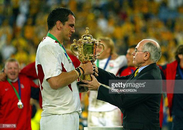 Australian Prime Minister John Hoxard presents the Web Ellis Cup to English captain and lock Martin Johnson after the Rugby World Cup final at the...