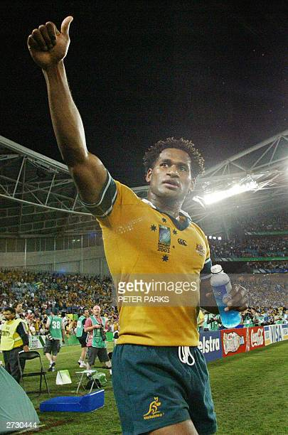 Australian winger Lote Tuqiri celebrates at the end of the Rugby World Cup semi final match between New Zealand and Australia at the Telstra Stadium...