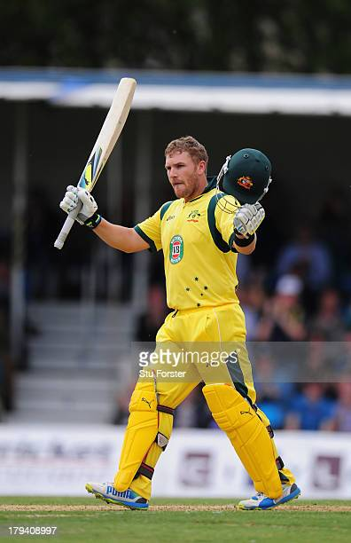 Australia batsman Aaron Finch celebrates his century during the One Day International between Scotland and Australia at the Grange on September 3,...