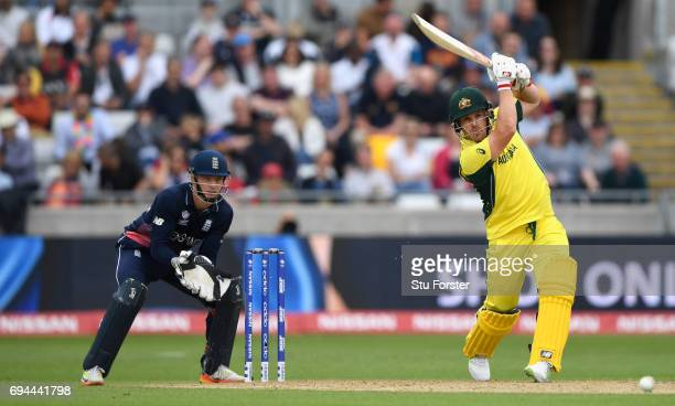 Australia batsman Aaron Finch hits out watched by Jos Butler during the ICC Champions Trophy match between England and Australia at Edgbaston on June...