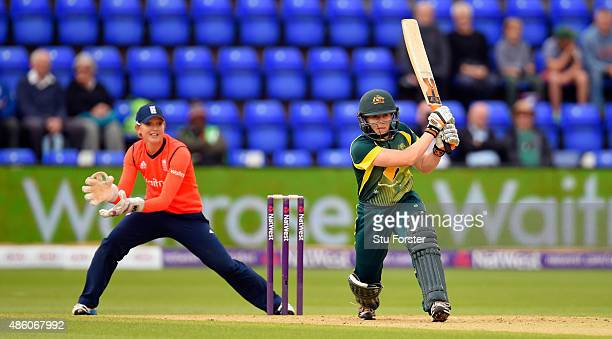 Australia batsman Alex Blackwell hits out as wicketkeeper Sarah Taylor looks on during the 3rd NatWest T20 of the Women's Ashes Series between...