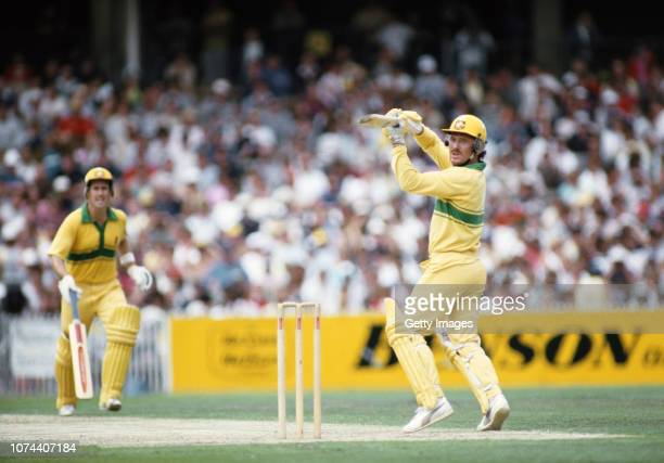 Australia batsman Allan Border finely cuts a ball to pick up some runs watched by Graeme Wood during the 2nd BH Series ODI Final against the West...