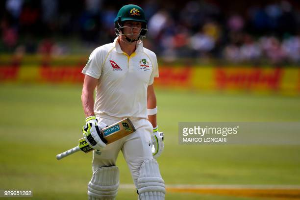 Australia batsman and captain Steve Smith leaves the ground after having been dismissed by South Africa bowler Kagiso Rabada during day one of the...
