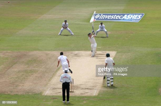 Australia batsman Brad Haddin scores runs driving England bowler James Anderson for 4 runs during the 5th day of the First Investec Ashes Test match...