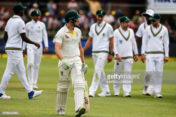 Australia batsman Cameron Bancroft leaves the ground after having been dismissed by South Africa bowler Vernon Philander during day one of the second...