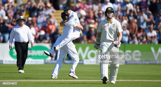 Australia batsman Chris Rogers leaves the field after being dismissed for 95 as bowler Mark Wood and Adam Lyth celebrate during day two of the 1st...