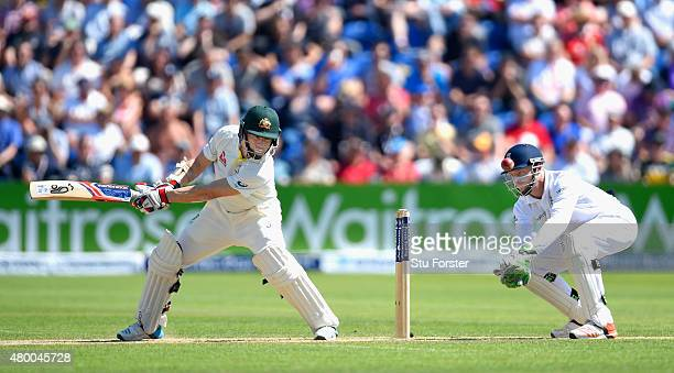 Australia batsman Chris Rogers picks up some runs watched by Jos Buttler during day two of the 1st Investec Ashes Test match between England and...