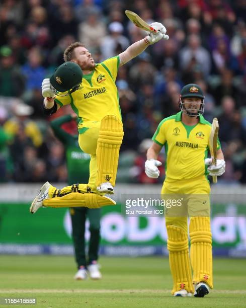 Australia batsman David Warner celebrates his century during the Group Stage match of the ICC Cricket World Cup 2019 between Australia and Pakistan...