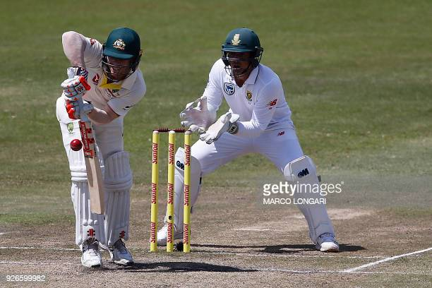 Australia batsman David Warner is hit by the ball during day three of the first Sunfoil Test between South Africa and Australia at the Kingsmead...