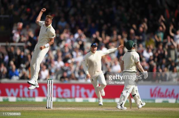 Australia batsman David Warner reacts as England bowler Stuart Broad celebrates his wicket during day four of the 4th Ashes Test Match between...