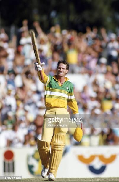 Australia batsman Dean Jones celebrates his One Day International century against Pakistan in the B&H Perth Challenge at the WACA on January 2, 1987...