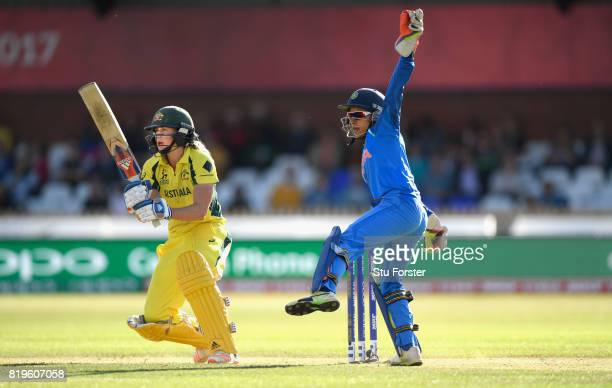 Australia batsman Ellyse Perry hits out watched by India wicketkeeper Sushma Verma during the ICC Women's World Cup 2017 SemiFinal match between...