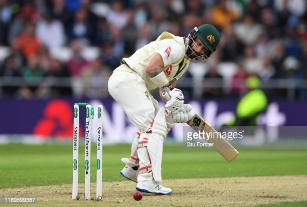 Australia batsman Matthew Wade turns around to see the bail falling off and is out for 0 off the bowling of Jofra Archer during day one of the 3rd...