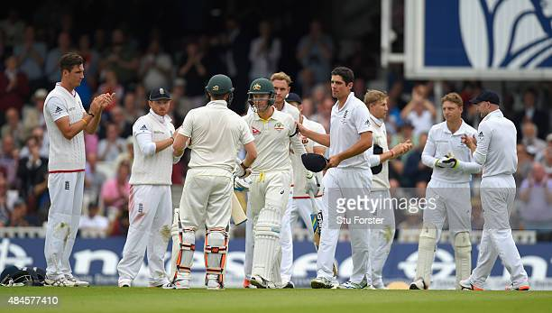 Australia batsman Michael Clarke is clapped to the wicket on his last test match by England captain Alastair Cook and his team during day one of the...