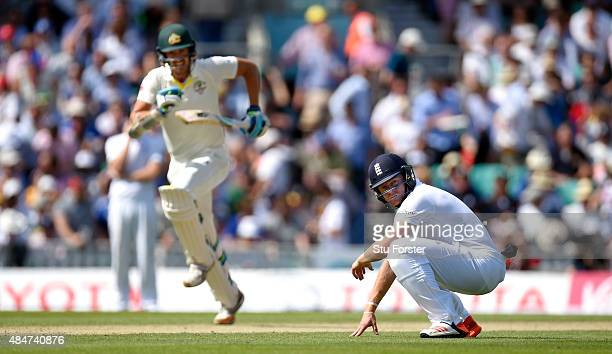 Australia batsman Mitchell Starc picks up runs as fielder Jonathan Bairstow looks on during day two of the 5th Investec Ashes Test match between...