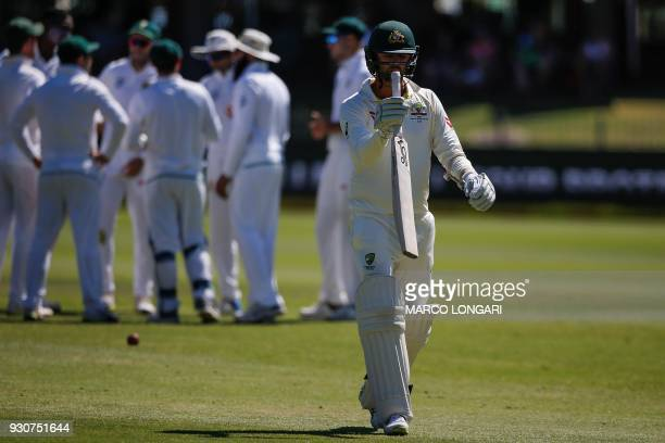 Australia batsman Nathan Lyon leaves the ground after having been dismissed by South Africa bowler Lungi Ngidi during day four of the second Cricket...