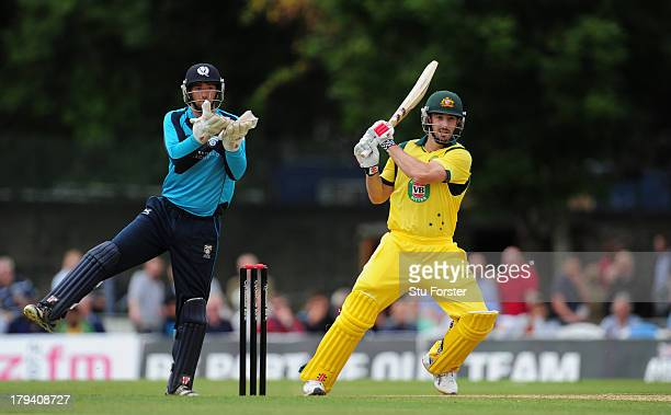 Australia batsman Shaun Marsh pulls a ball towards the boundary watched by Scotland keeper David Murphy during the One Day International between...