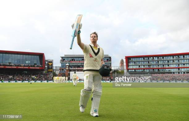 Australia batsman Steve Smith acknowledges the applause whilst leaving the field after being dismissed for 211 runs during day two of the 4th Ashes...