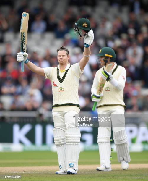 Australia batsman Steve Smith celebrates after reaching his century as Tim Paine applauds during day two of the 4th Ashes Test Match between England...