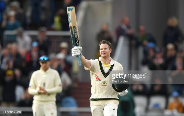 Australia batsman Steve Smith celebrates after reaching his double century as Joe Root applauds during day two of the 4th Ashes Test Match between...