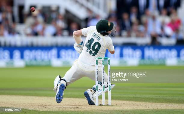 Australia batsman Steve Smith is hit on the helmet by a ball from Jofra Archer during day four of the 2nd Test Match between England and Australia at...