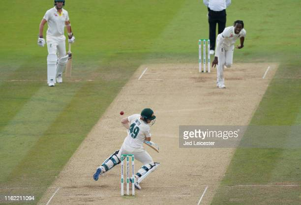 Australia batsman Steve Smith is hit on the neck from a high ball from England bowler Jofra Archer at Lord's Cricket Ground on August 17, 2019 in...