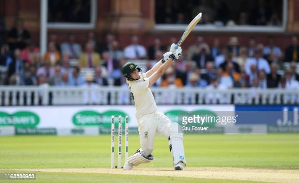Australia batsman Steve Smith pulls a ball from Woakes to the boundary for his first runs after returning back to the crease after retiring hurt...