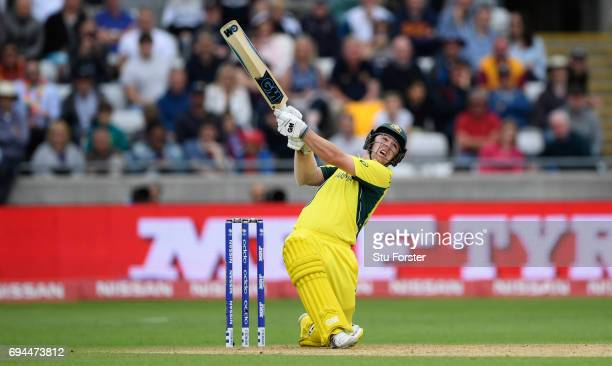 Australia batsman Travis Head hits out during his half century during the ICC Champions Trophy match between England and Australia at Edgbaston on...