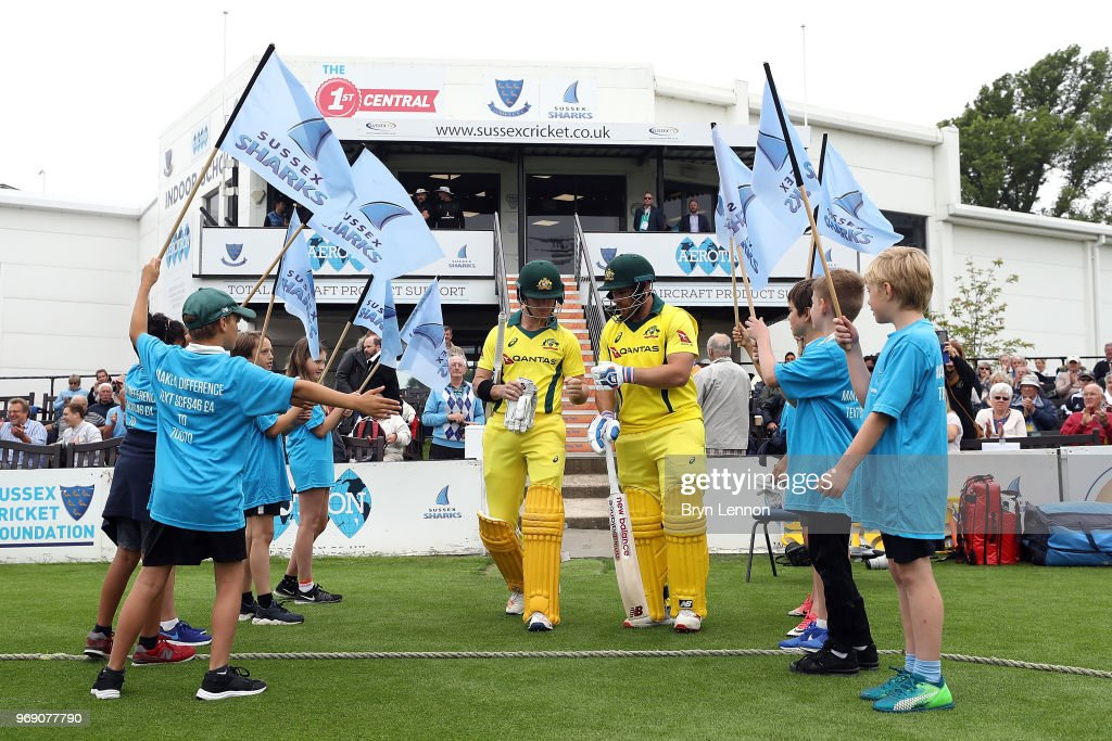Australia batsmen D'Arcy Short and Aaron Finch walk out at the start of the one day tour match between Sussex and Australia at The 1st Central County Ground on June 7, 2018 in Hove, England.