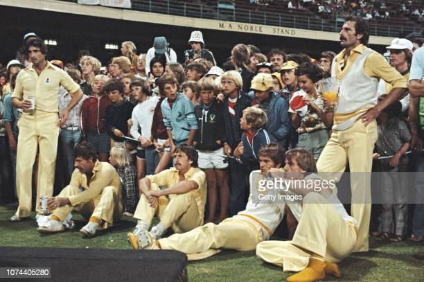 Australia bowler Dennis Lillee holding a jug of Orange Juice David Hookes Kepler Wessels Bruce Laird Rod Marsh and Len Pascoe standing react after...