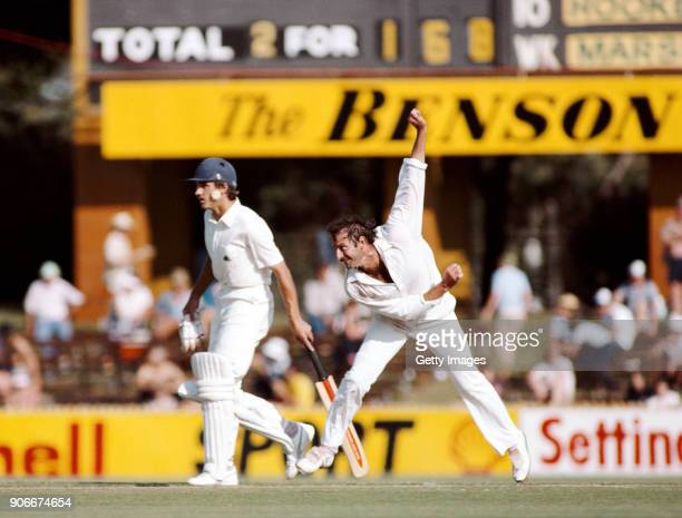 Australia bowler Dennis Lillee in action as non striking England batsman Chris Tavare looks on during the opening day of the 1982/83 Ashes series at...