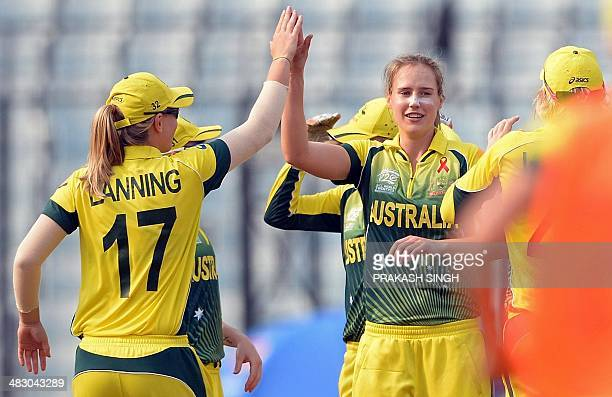 Australia bowler Ellyse Perry celebrates the wicket of England batswoman Amy Jones with teammates during the ICC Women's World Twenty20 final between...