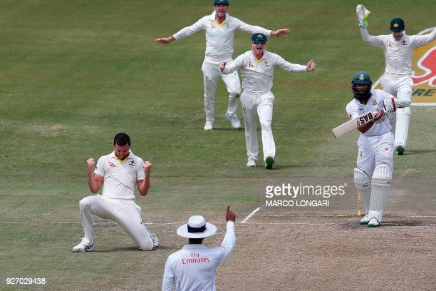 TOPSHOT Australia bowler Josh Hazlewood celebrates taking the wicket of South Africa batsman Hashim Amla during the fourth day of the first Test...