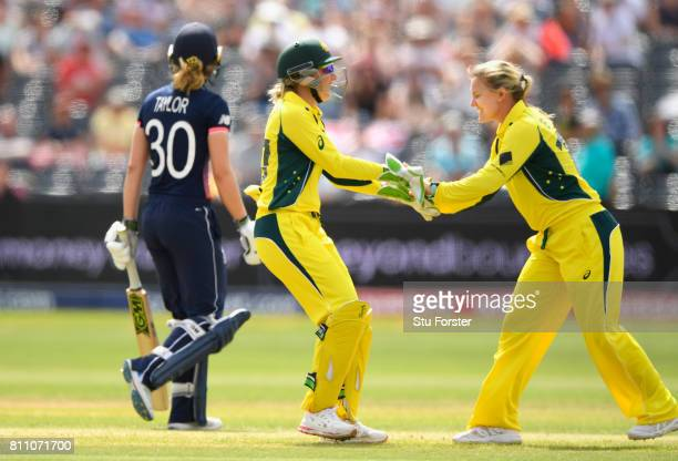 Australia bowler Kristen Beams is congratulated by Healy after bowling Sarah Taylor during the ICC Women's World Cup 2017 match between England and...