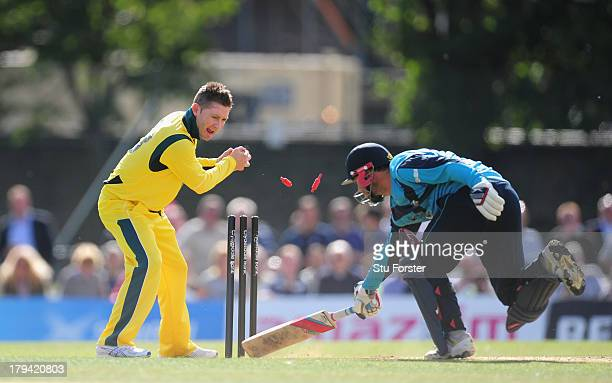 Australia bowler Michael Clarke runs out Scotland batsman Preston Mommsen during the One Day International between Scotland and Australia at the...