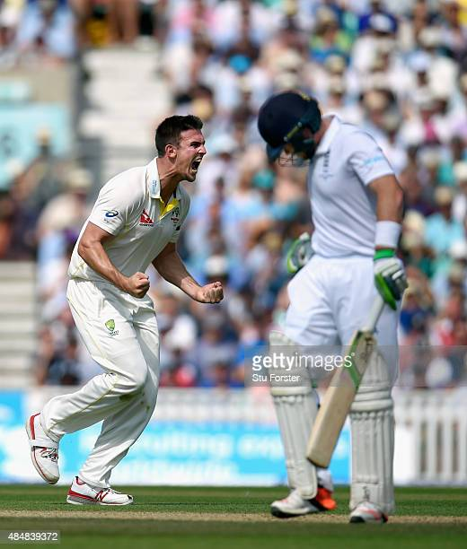 Australia bowler Mitchell Marsh celebrates after dismissing England batsman Ian Bell during day three of the 5th Investec Ashes Test match between...