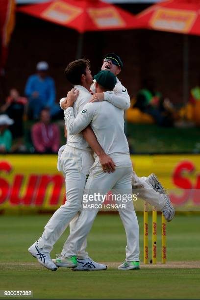 Australia bowler Mitchell Marsh is congratulated after taking the wicket of South Africa batsman Theunis de Bruyn during the second days play of the...