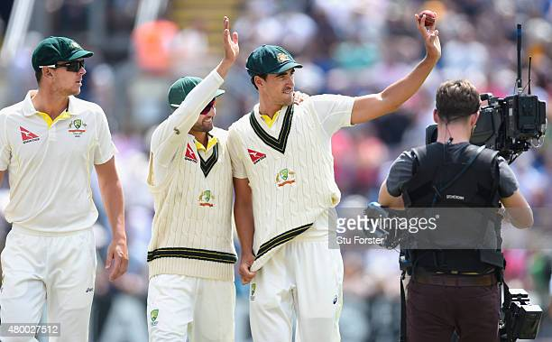 Australia bowler Mitchell Starc celebrates his five wicket haul with Nathan Lyon during day two of the 1st Investec Ashes Test match between England...