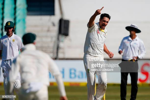 Australia bowler Mitchell Starc celebrates the wicket of South Africa batsman Faf du Plessis during day two of the first Test cricket match between...